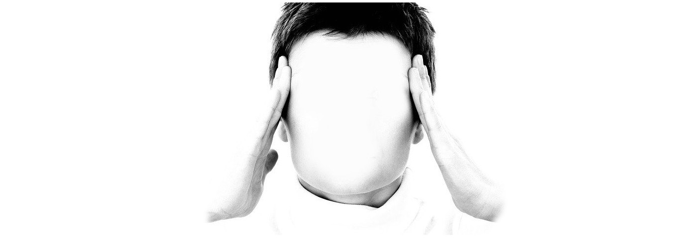A man holding his head discouraged from his erectile dysfunction problem.